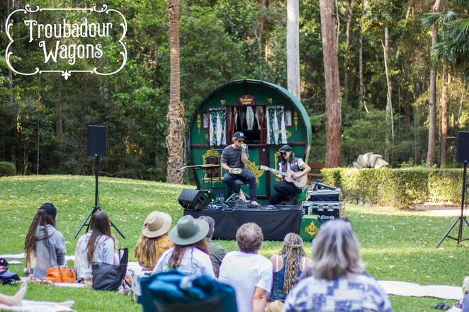 Secret Garden Micro Event, Troubadour Wagons, Maroochy Bushland Botanical Gardens, laid-back, family-friendly, live music, first Sunday of every month, inspired by 13th-century travelling artists, poets, players, mobile entertainment venue, available for hire, weddings, milestone birthday celebrations, local and touring artists, folksy tunes, gritty blues, reggae vibes, sweet pop sounds, January feature artists, The Dawn Light, The Letter Elle, children under 5 free, covid safe regulations, friends, family, picnic rug, Sculpture Garden