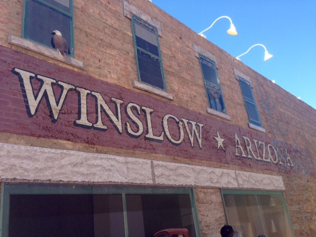 standing on the corner, winslow arizona, take it easy the eagles, route 66 through arizona, towns on route 66, the eagles, i was running down the road, famous songs by the eagles, disney pixar cars in winslow. driving route 66
