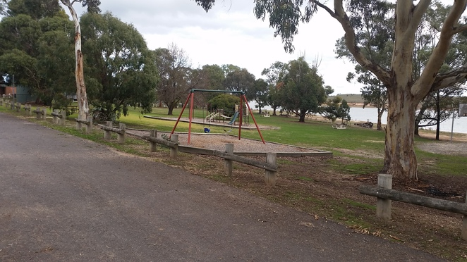 A well appointed playground with plenty of room for the kids to run around.