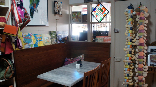 Slip into a quiet booth in Cafe 4342