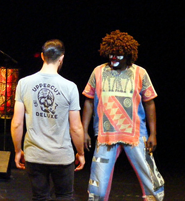 A clown interacts with a member of the audience