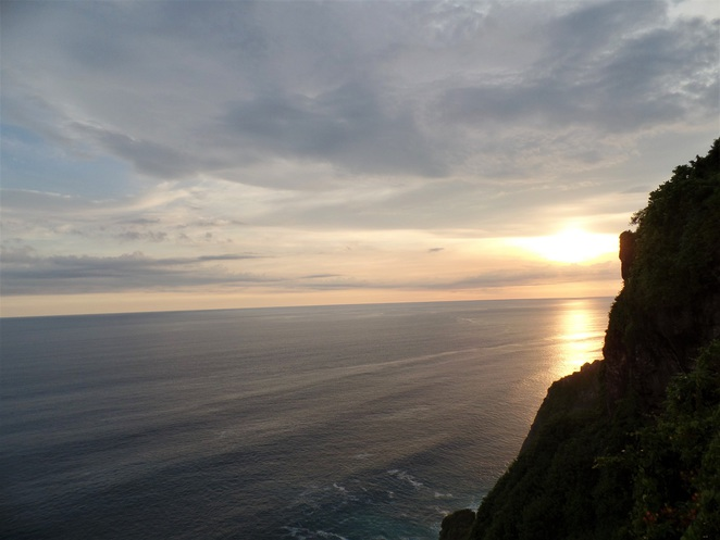 view of sunset from cliff in Jimbaran, Bali