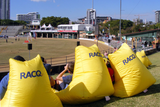 People chilling out at the mound at the main arena at Ekka
