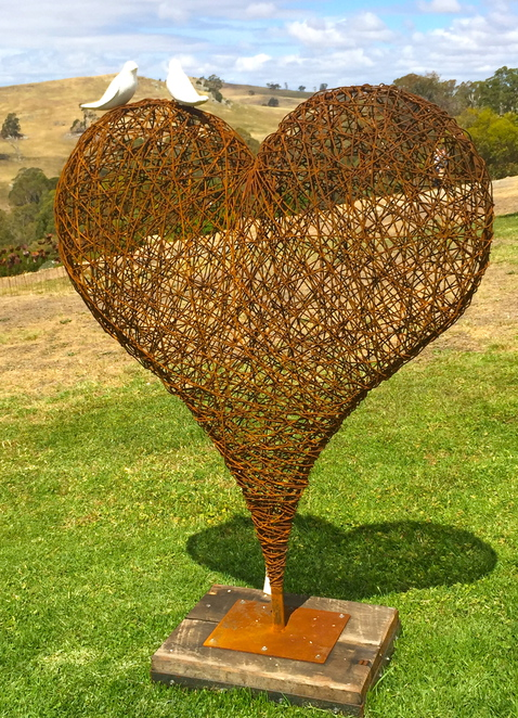 large sculpture, heart, wire, doves, love