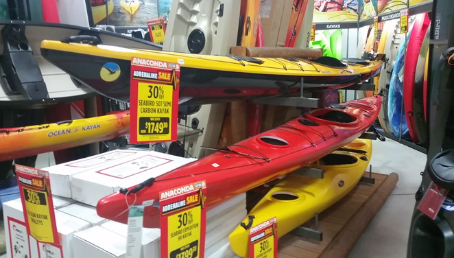 The many different canoes and kayaks have different capabilities and uses
