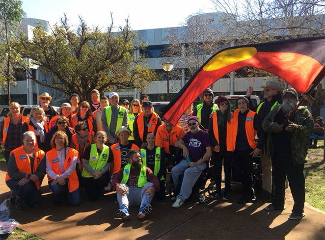Perth Homeless Support Group Depot Open Day Volunteers with Indigenous flag