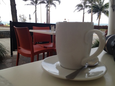Sit back, relax, and enjoy a coffee over the road from Mooloolaba Beach