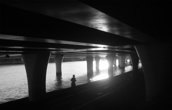 Walking under the freeway by the river