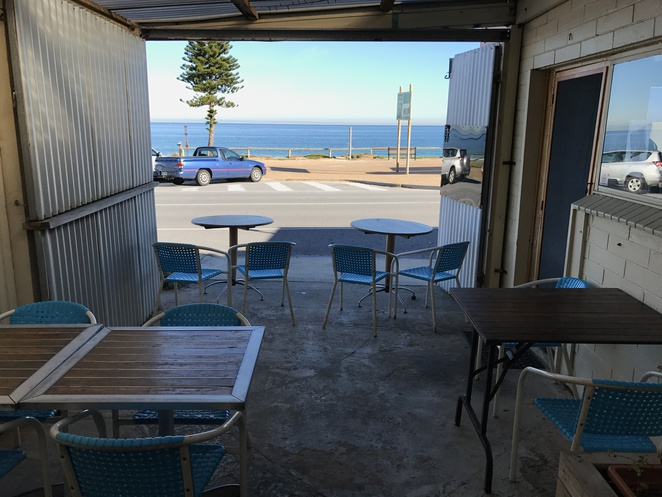 Ripple and Swirl Cafe Christies Beach Outside Courtyard overlooking the beach sea ocean