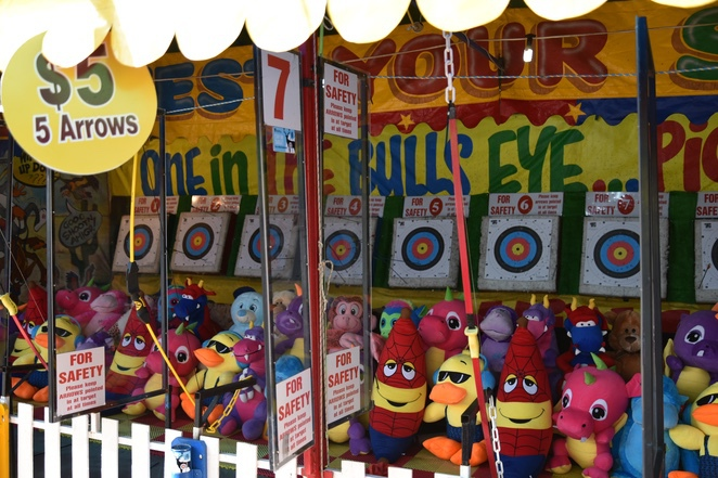 Carnival games, archery, giant stuffed toy, easter show, Sydney Royal Easter Show
