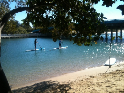 check out the stand-up paddle boarders