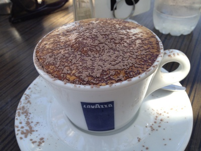 Enjoy a nice, hot cappuccino at Coffee Cat