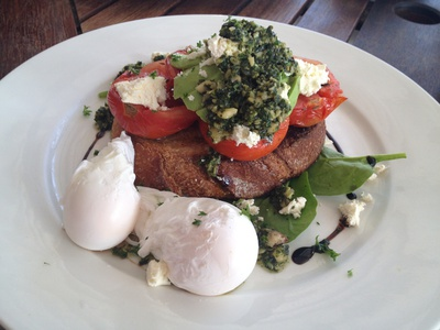 The slow roast tomatoes, hinterland avocado, feta and basil pesto on organic sourdough toast (with two eggs for additional $3)