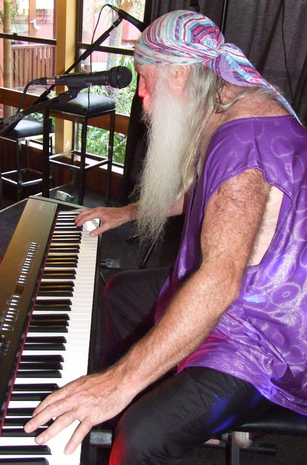 wizard, virtuoso, pianist, vocalist, composer, improvisor, jazz, blues, classical, performance, magical, music, wizardry, mastery, keyboard,