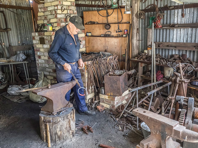 Master craftsman, Malcom Paine with some of the many and varied tools of his blacksmith trade. Photo courtesy Busselton Historical Society.