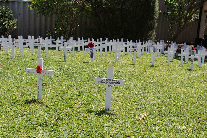 ANZAC Cottage Remembrance Day Commemoration. White crosses cover the front lawn of ANZAC Cottage.