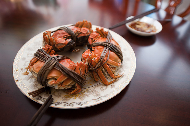 Cooked crabs are displayed on a dining table in Beijing