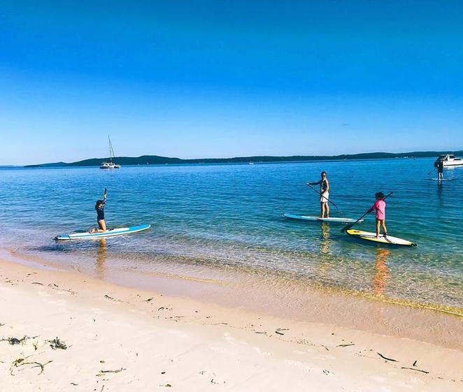 stand up paddle boards, SUP, port stephens surf school, dutchmans beach, things to do, SUP lessons, SUP hire, swimming, best bays, nelson bay, port stephens, NSW,