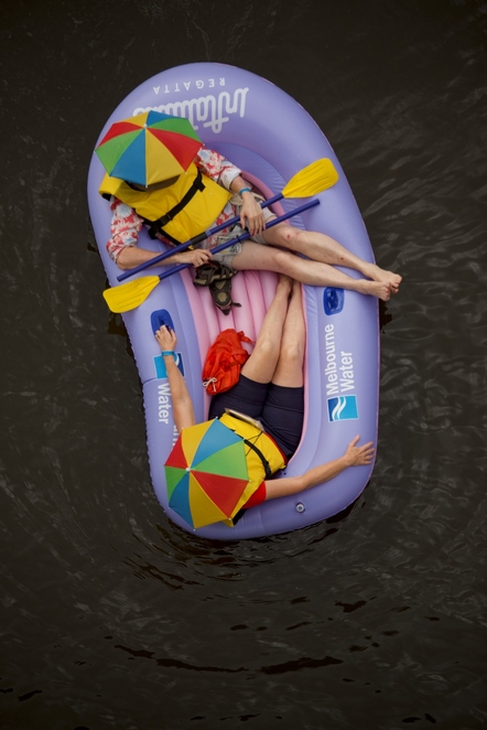 inflatable,regatta,melbourne,river,boat,fun,colour,umbrella,red,yellow,water