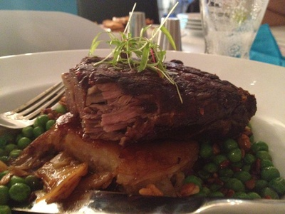 Twice cooked lamb shoulder with dauphinoise potatoes, toasted macadamia, sweet peas and lamb jus ($27)