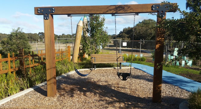 Armstrong Creek Park, Armstrong Creek Playground, play equipment, swingset, swings,