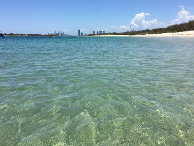 Beautifully clear water and a long sandy beach at Wave Break Island
