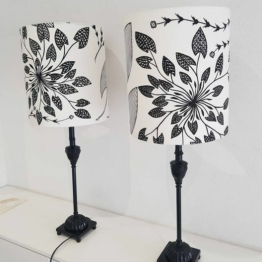 Pair of lampshades made from Injalak Arts, Waterlillies linen fabric designed by Eva Nganjmirra. Vintage lamp bases. Image Fabric for Life Facebook Page