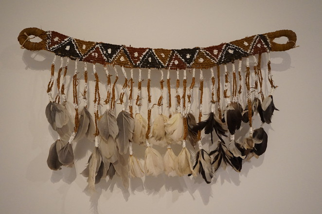 A fibre art work with feathers