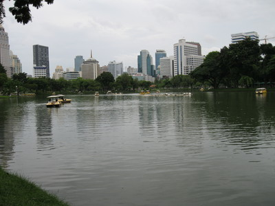 Boating lake with cityscape backdrop