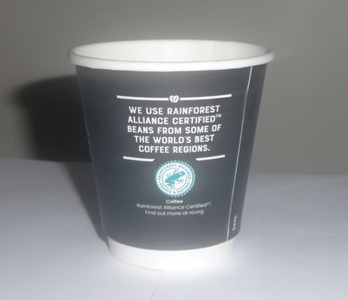 An empty coffee cup which if filled costs a dollar