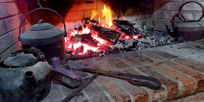 In winter, enjoy wine and food by an open fire