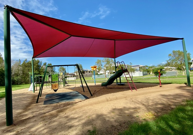 Manning Esplanade Park's swings and play equipment