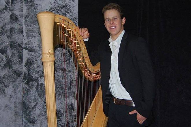 The author Geraldine Brook's son. Ten years ago, he was a nine-year-old boy who wanted to play the harp. He is seen here at the book launch in 2015, with harp.