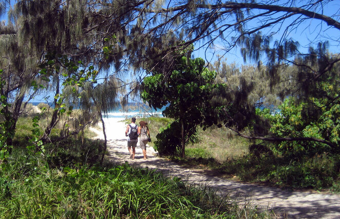 There are side paths down to the beach all along the path
