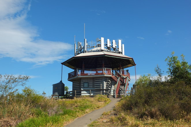 Wild Horse Mountain Lookout, fire tower, 123 metres above sea level, steep incline, panoramic views, Glass House mountains, Bribie, Pumicestone Passage, Brisbane, interpretive boards, dogs on a leash