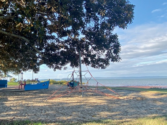 The playground overlooks a little sandy beach that often proves irresistable to kids of all ages