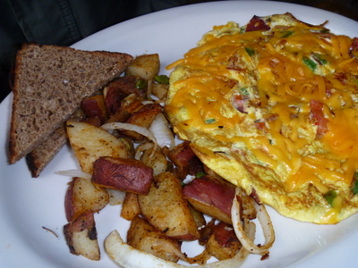 American Omelette and potatoes with toast at Willburg Cafe