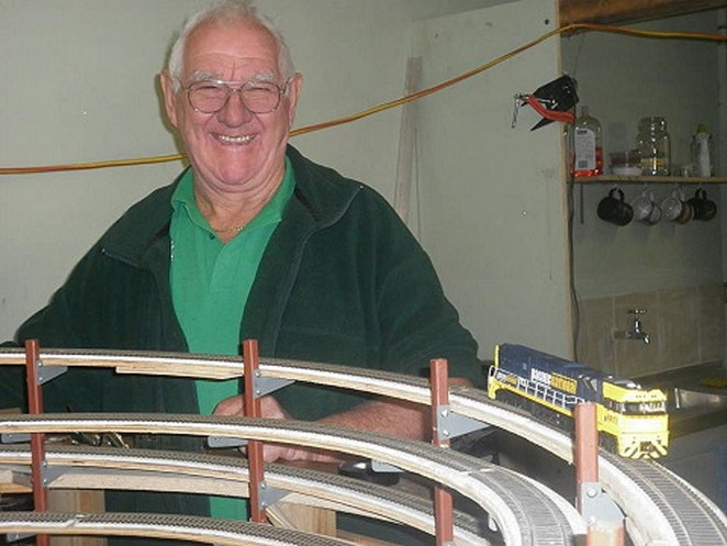 Railway member, Harry, proudly displaying the helix that enables the model trains to access different levels of the layout at the South West Rail and Heritage Centre