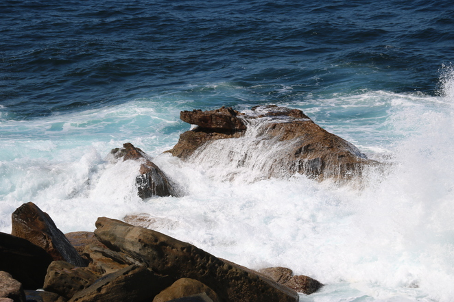 Sea water hitting the cliffs