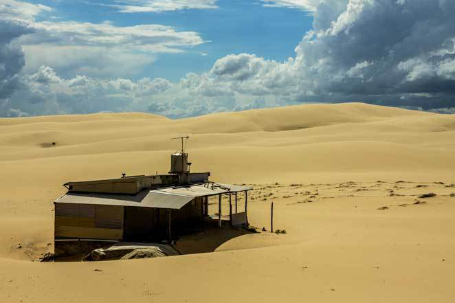 Tin City, Stockton Beach, sand dunes, storm, fishing shack,