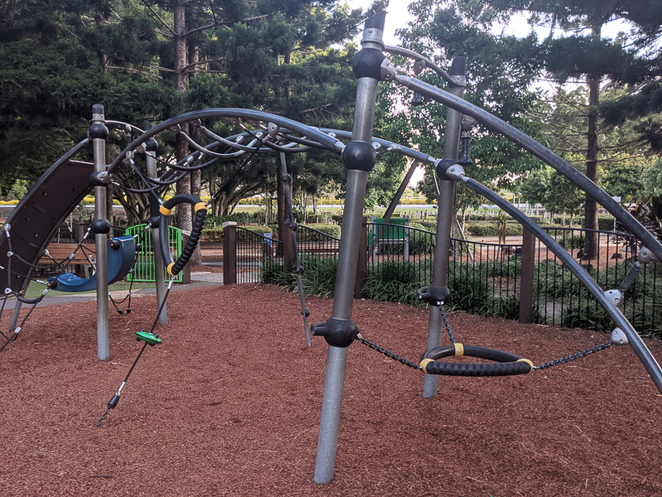 Play equipment amongst the trees at Pine Rivers Park