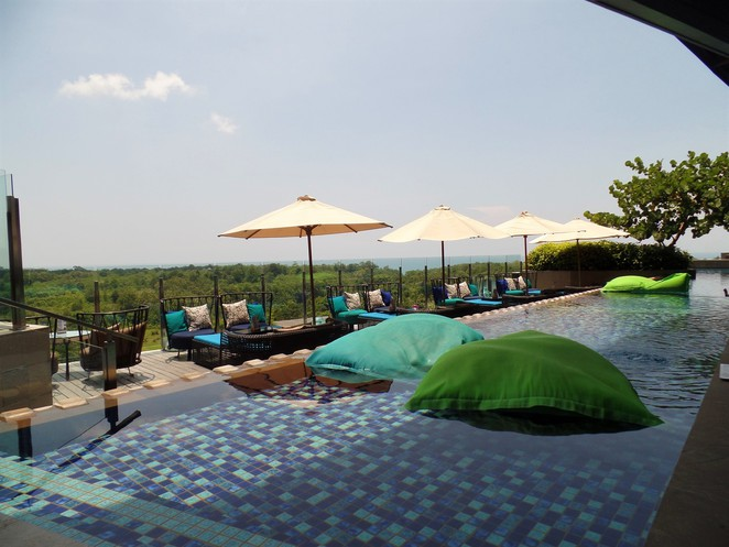 view from pool in UNIQUE Rooftop Bar & Restaurant at Rimba Jimbaran Bali by AYANA