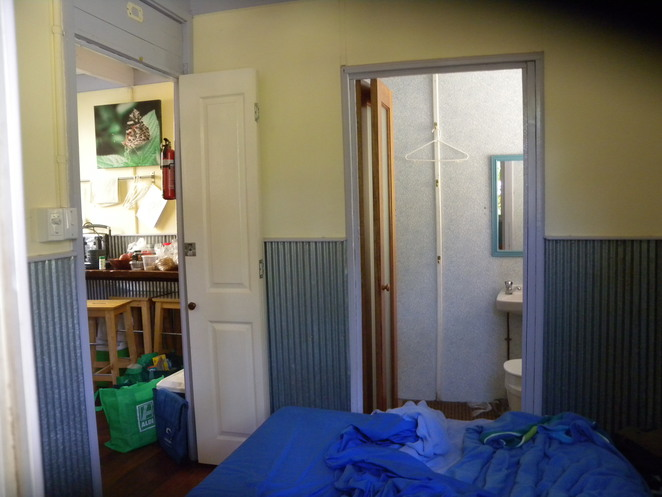 Looking from bedroom towards ensuite bathroom and kitchen