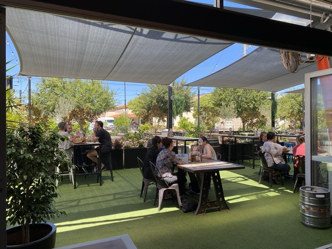 outdoor seating at two43 bar