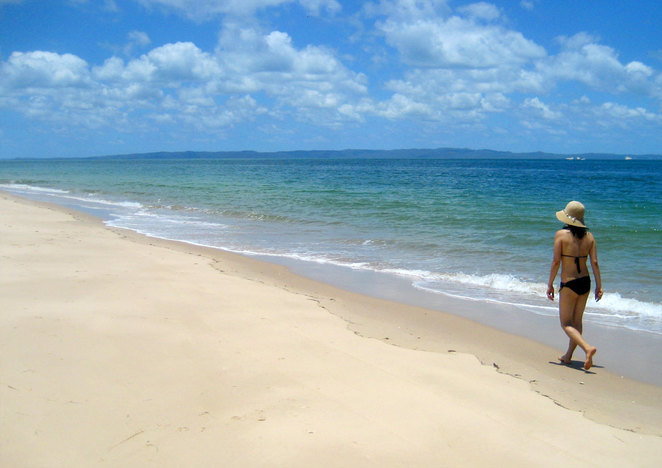 Walking along Red Beach on Bribie Island, far from others