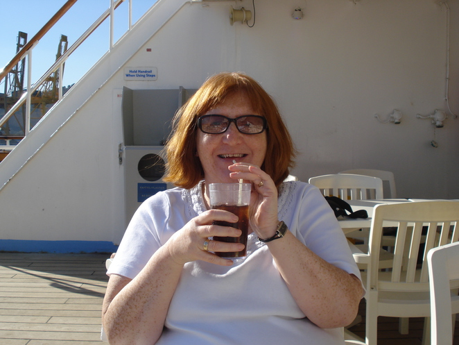 Margaret sips drink on cruise ship