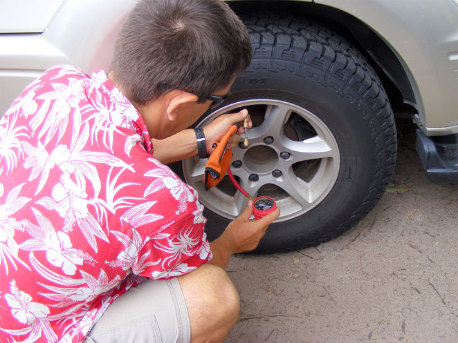 Letting the air out of your tires before driving on the beach increases traction