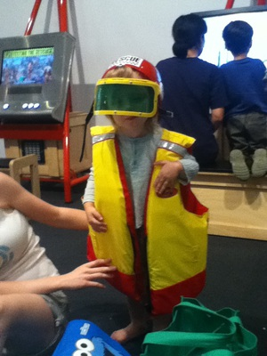 rescue outfit, dress ups, child dressed up as rescue worker, Ipswich Art Gallery