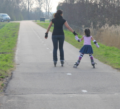 mommy and daughter on roller blades