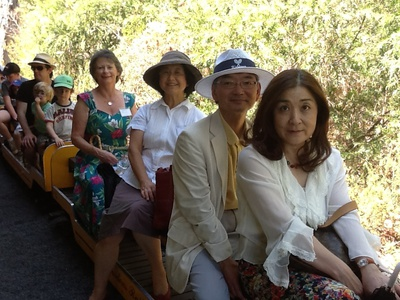 The Consul General of Japan and his wife and party enjoy the miniature train ride